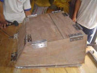 The hinged sides of the solar box cooker mold make precise bends in the aluminum